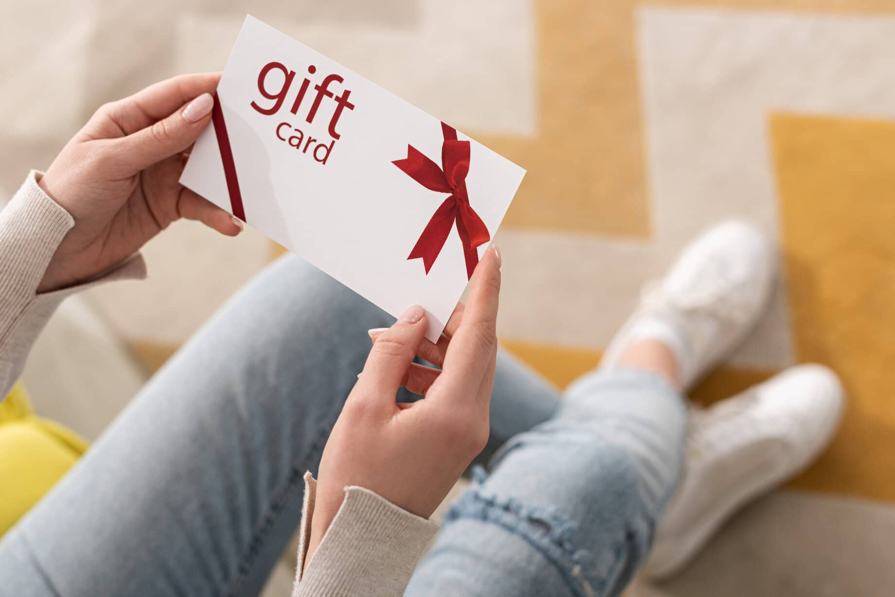 woman holding a gift card